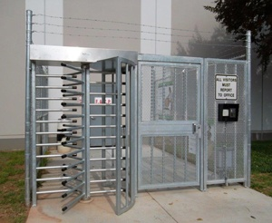 Gate beside full height turnstile for ADA access