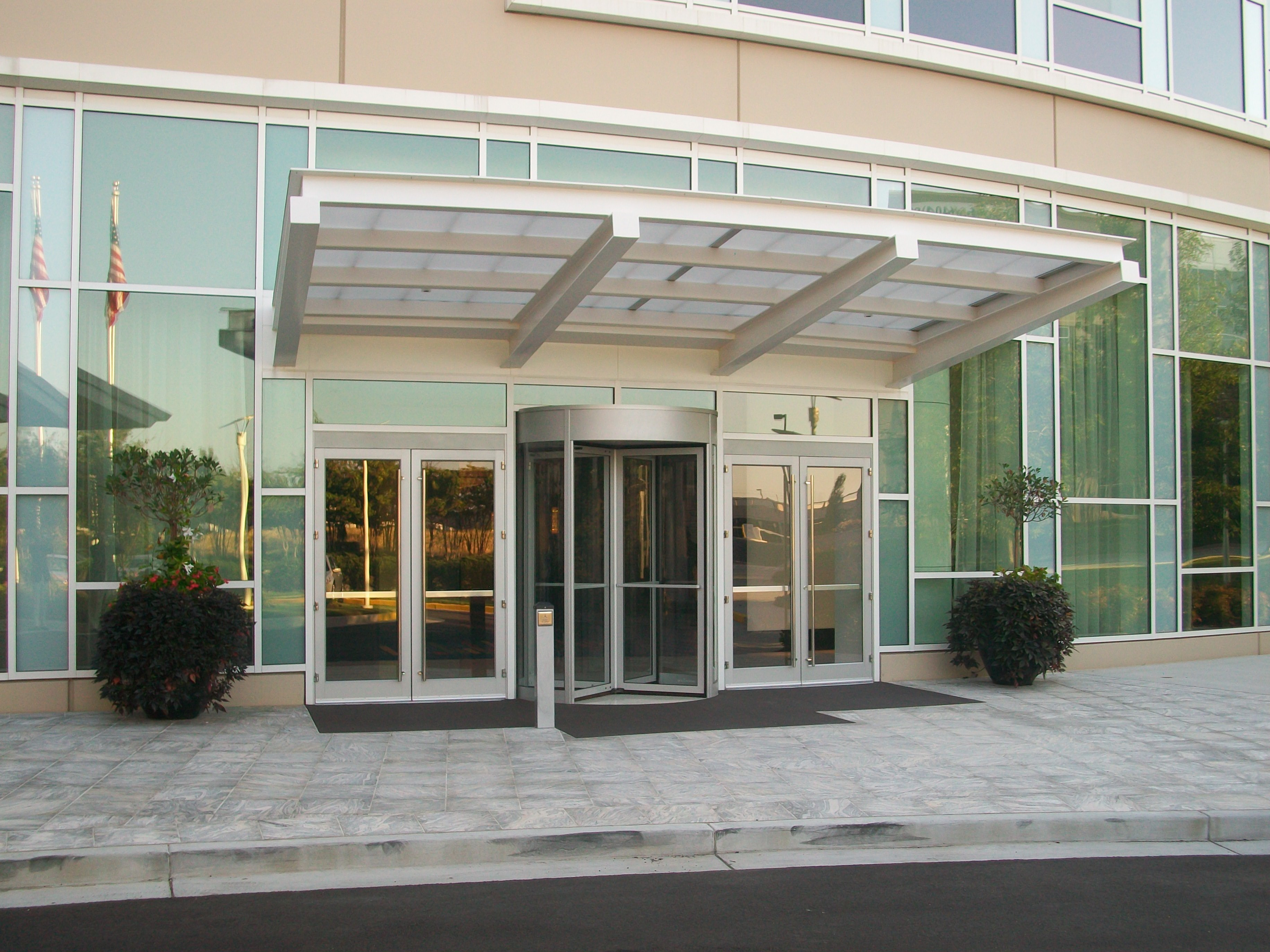 Revolving Doors Outside a Building Require a Protective Overhang